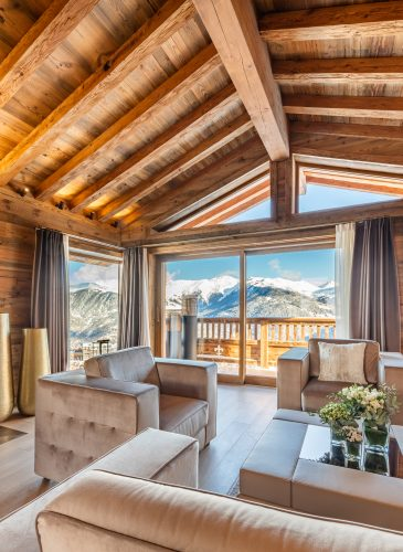 Ultima Courchevel - Living Room Fireplace and View